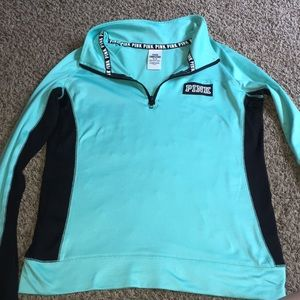 I'm selling a Turquoise Pink running shirt